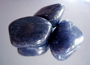 3 color blue aventurine stone on a table