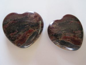 2 shiny stones with a heart shape