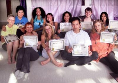 a group of people taking a picture while holding their apprenticeship certification from reiki wellbeing