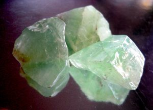 3 color green healing calcite stone on the table