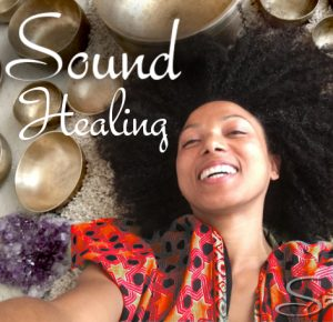 an image of a woman lying beside a bronze bowls smiling and a text in the upper left that reads sound healing