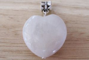 a color white jade pendant with a heart shape